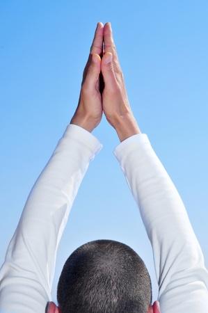 salutation: a yogi practicing the sun salutation