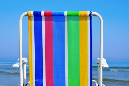 a colorful deckchair on the beach in the summer Stock Photo - 13232970