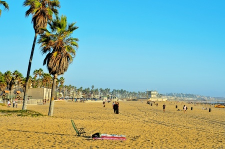 los angeles county: Venice, US - October 17, 2011: View of Venice Beach with its Pier in the background in Venice, US. Dozen of movies are filmed in the Venice Pier, a 1,310-foot (400 m) concrete structure Editorial