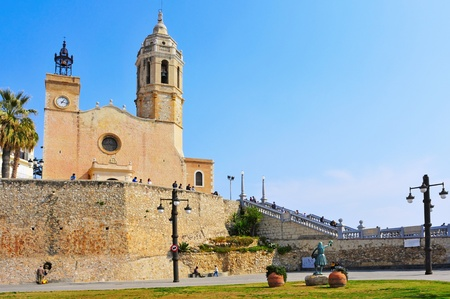 Sitges, Sspain - March 3, 2012: Church of Sant Bartomeu i Santa Tecla in Sitges, Spain. The 17th century church next to the sea is an iconic building of the gay-friendly city