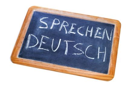 spoken: sentence sprechen deutsch, german is spoken, written on a chalkboard Stock Photo