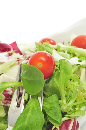 cornsalad: closeup of a plate of salad with cherry tomatoes