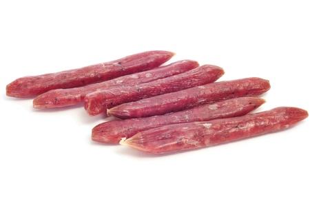 llonganissa: some fuet, spanish salami, on a white background Stock Photo