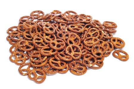 pretzels: a pile of pretzels on a white background