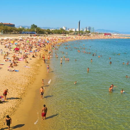 urban redevelopment: Barcelona, Spain - August 16, 2011: La Nova Icaria Beach in Barcelona, Spain. This beach, 400 meters long, arised with the urban redevelopment on the occasion of the 1992 Olympic Games Editorial