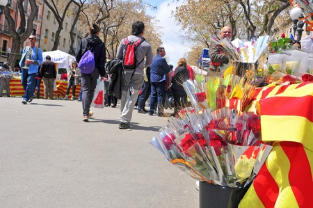 sant: Tarragona, Spain - April 23, 2012: Saint Georges Day in Tarragona, Spain. Every April 23th, red roses and books are sold in stalls in Rambla Nova, the most important street in the city