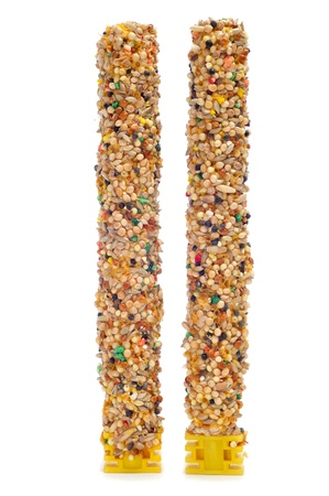 vertical bars: some birdseed bars on a white background