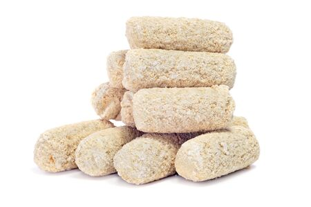 croquettes: some frozen spanish croquettes on a white background Stock Photo