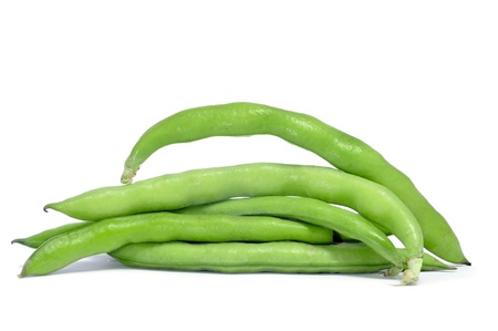 a pile of broad bean pods with the beans inside on a white background photo