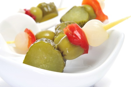 spanish banderillas, skewers with pickling olives, garlic, pickles, onion and red pepper