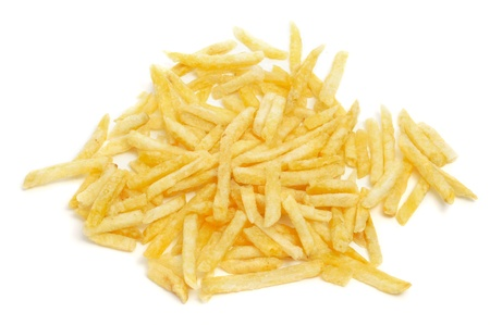 papas fritas: un montón de papas fritas francés sobre un fondo blanco Foto de archivo