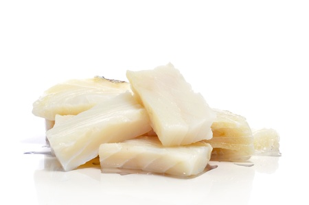 some pieces of raw cod on a white background