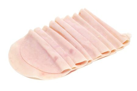 embutido: some slices of turkey ham on a white background