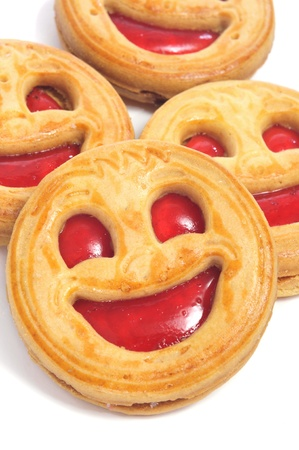 closeup of some smiley biscuits on a white background Stock Photo - 13545668