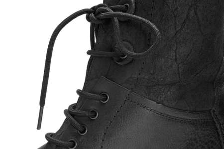 footgear: closeup of a black leather boot for men Stock Photo