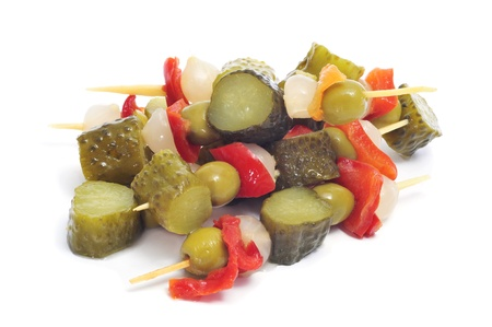 spanish banderillas, skewers with pickling olives, garlic, pickles, onion and red pepper photo