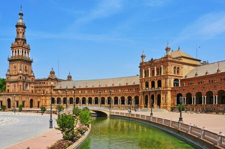 andalusia: Seville, Spain - May 17, 2012: View of Plaza de Espana in Seville, Spain. Plaza de Espana complex, built in 1929, is a huge half-circle with a total area of 50,000 square meters