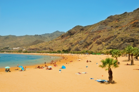 Tenerife, Spain - June 23, 2011: A view of Teresitas Beach in Tenerife, Canary Islands, Spain. This is the nearest beach to Santa Cruz and one of the few in the North-East of the island Stock Photo - 13860714