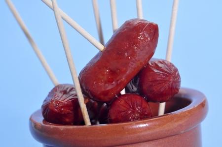 embutido: some red fried spanish chorizos served as tapas Stock Photo