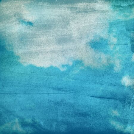 clouds on a textured paper background photo