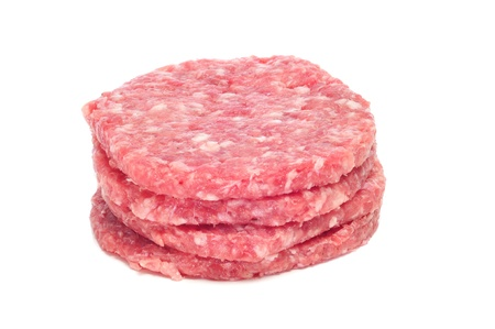 chicken burger: a pile of raw burgers on a white background Stock Photo