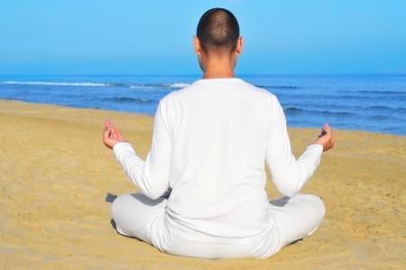 someone meditating on the beach Stock Photo - 13901118