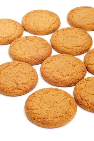 coconut sugar: closeup of a pile of biscuits on a white background