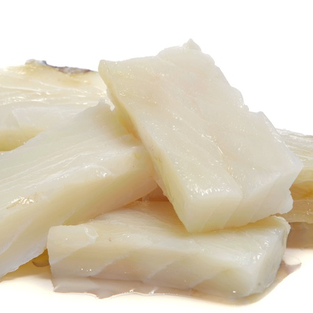 codfish: some pieces of raw cod on a white background