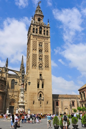 bell tower: Seville, Spain - May 18, 2012: Cathedral and La Giralda in Seville, Spain. La Giralda, 104.5 meters high, a former minaret that was converted to a bell tower, is the icon of Seville Editorial