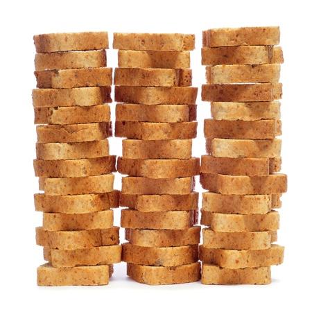 some piles of mini toasts on a white background photo