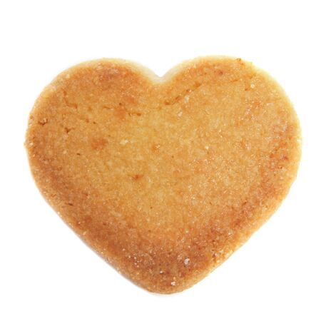 a heart-shaped shortbread biscuit on a white background photo