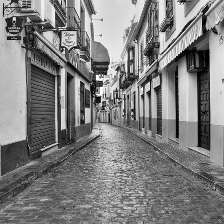 Cordoba, Spain - May 16, 2012: View of Deanes Street, in La Juderia district, in Cordoba, Spain. La Juderia is the most tourist district in the city, full of souvenir shops and restaurants