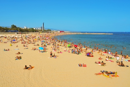 urban redevelopment: Barcelona, Spain - August 16, 2011: La Nova Icaria Beach in Barcelona, Spain. This beach, arised with the urban redevelopment on the occasion of the 1992 Olympic Games, is 400 meters long Editorial