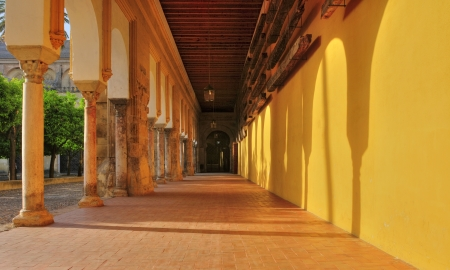 Cordoba, Spain - May 16, 2012: Patio de los Naranjos of Cathedral-Mosque of Cordoba, Spain. This unique building, mix of cultures, is one of the most visited tourist sites in Spain