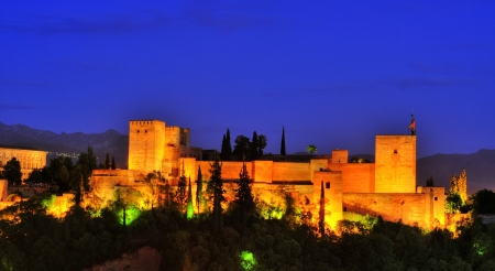 Granada, Spain - May 18, 2012: La Alhambra at night in Granada, Spain. In 2011 La Alhambra was the most visited monument in Spain, with the record of 2,310,764 visitors