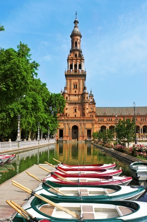 Seville, Spain - May 17, 2012: View of Plaza de Espana in Seville, Spain. Plaza de Espana complex, built in 1929, is a huge half-circle with a total area of 50,000 square meters