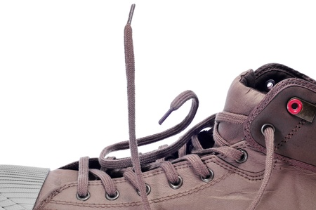 lace up: closeup of a casual sneaker boot on a white background Stock Photo