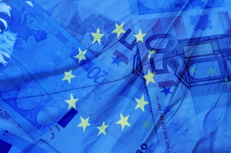 european exchange: blue background with euro bills and european union flag symbolizing euro zone