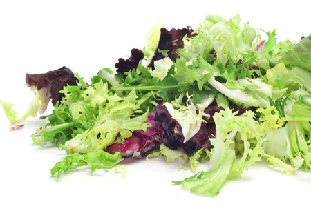 romaine: closeup of a pile of lettuce mix on a white background Stock Photo