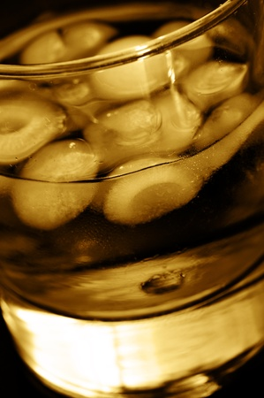 addictive drinking: closeup of a glass with mixed drink in a club Stock Photo