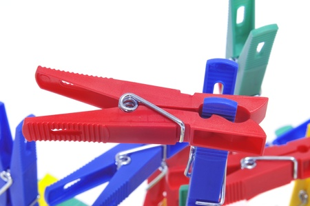 clothes pegs: a pile of clothespins of different colors on a white background