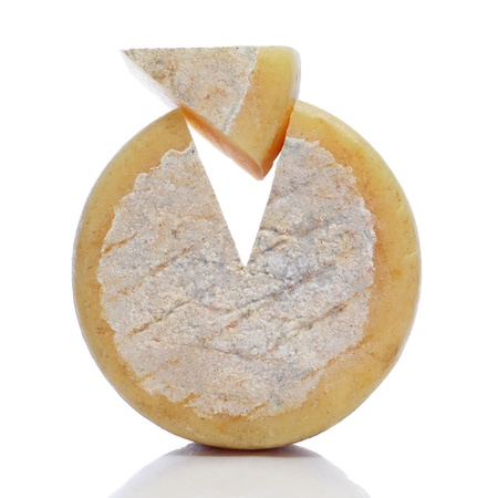 goat cheese: piece of cheese on a white background Stock Photo