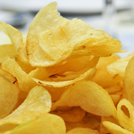 potato chip: closeup of a bowl with potato chips