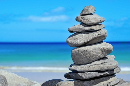 closeup of a stack of stones on a beach photo