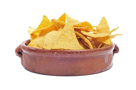 corn chip: earthware bowl with nachos on a white background Stock Photo