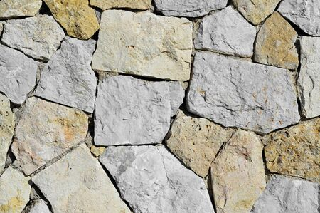 stonemasonry: background made of a close-up of a stone wall