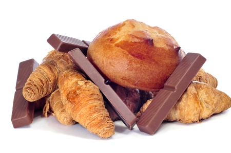 a pile of pastries, as croissants, and pieces of chocolate on a white background photo
