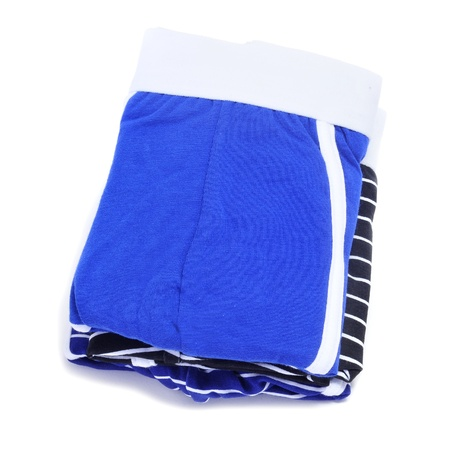a pile of folded boxer briefs of different colors on a white background photo