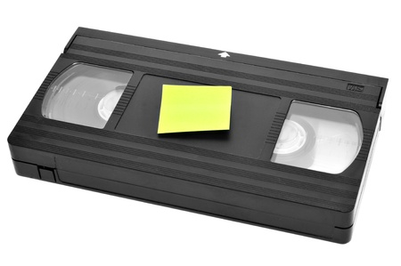 vhs videotape: a videotape with a blank sticky note on a white background Stock Photo