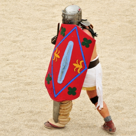 a gladiator on the arena of a amphitheater photo